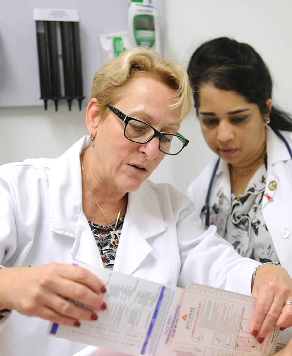 two DNP nursing students examine test results